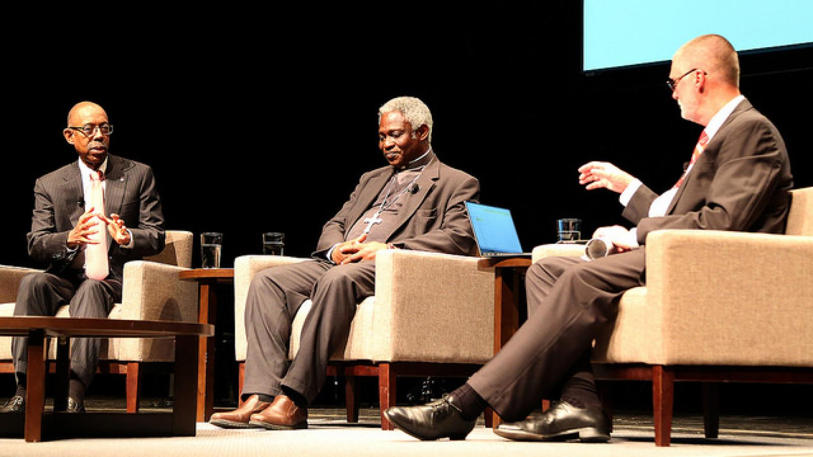 Cardinal Peter Turkson enjoys a fireside chat with President Drake